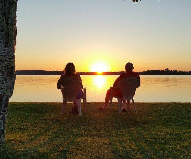 two people sitting watching sunset